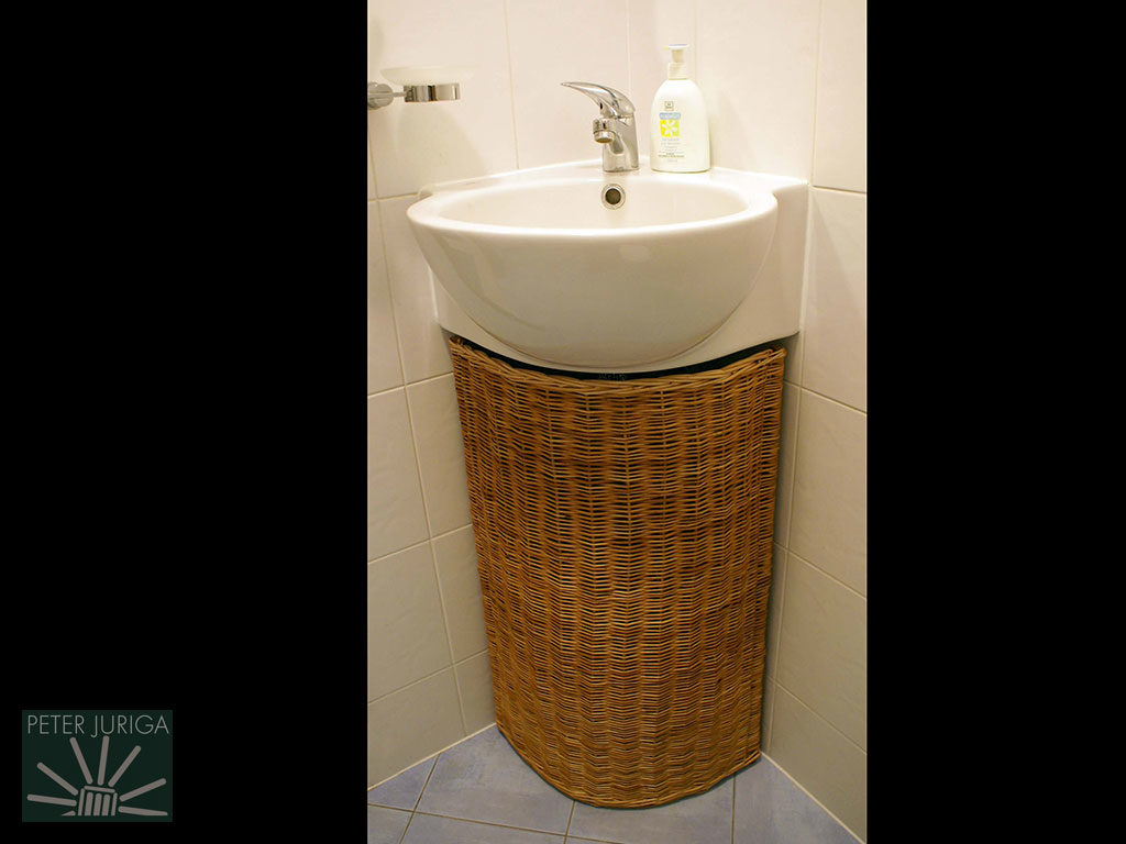 2009-5 A made-to-order under sink laundry basket, which is functional while aesthetically covering the water pipes | Peter Juriga