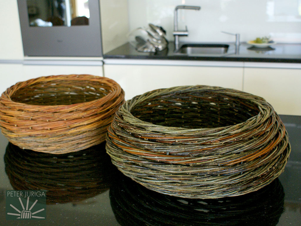 2014-8 On the left is bowl made in January of fresh willow and at the right is one made from dry rods. Both are made from Purpurea willow, which often dramatically changes to a dark gray color once soaked   Peter Juriga